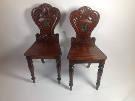 Pair of Mahogany Armorial Hall Chairs